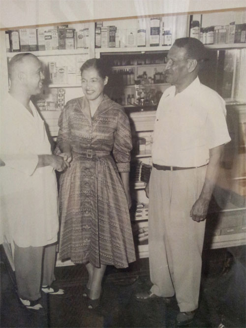 Dr. Richard Harris, Jr., Rosa Parks, unknown at Dean Drug Store circa 1955-56